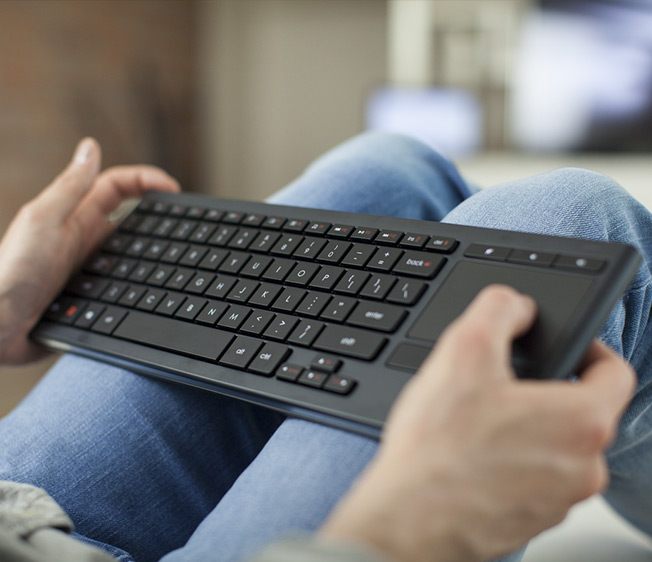 K830 illuminated living room keyboard in use