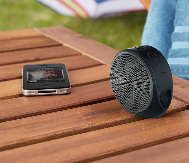 X100 Bluetooth speaker in use with phone