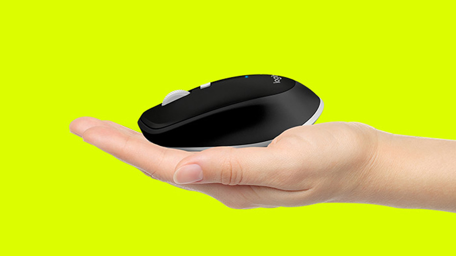 Feature - Compact mobile design - hand holding sm black mouse