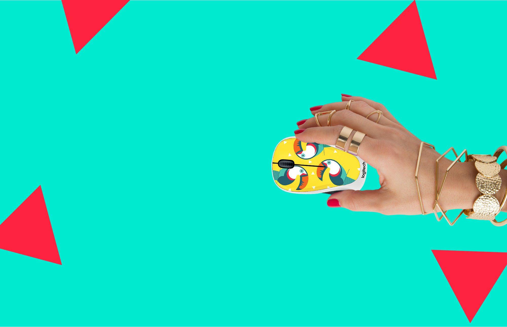 Womans hand using the M238 Toucan mouse